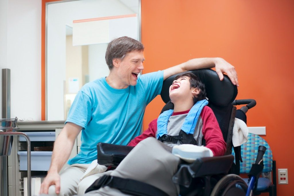 Father taking care of a child with special needs